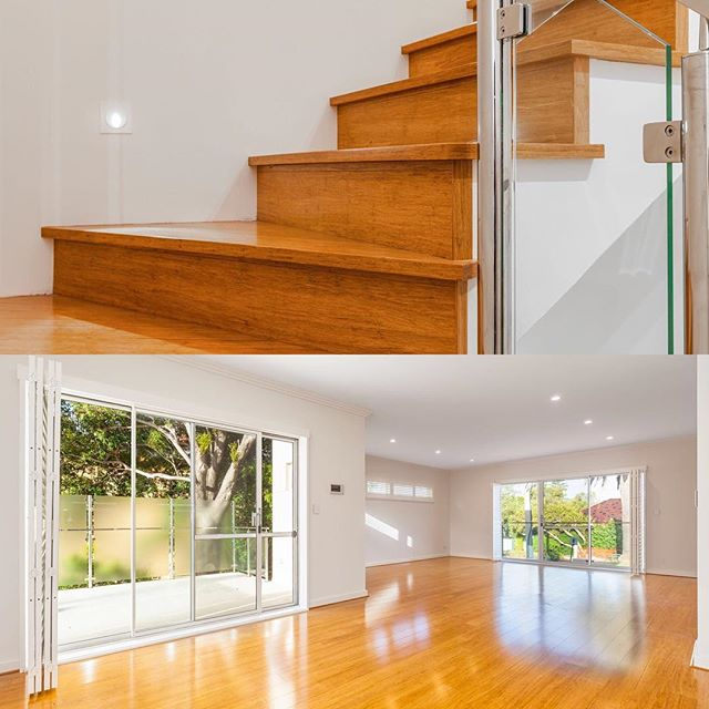 Natural stained hardwood flooring and staircase