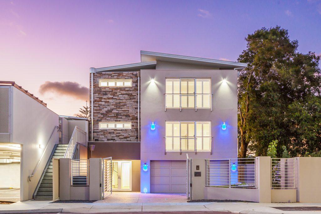 Nedlands three storey house with a large garage