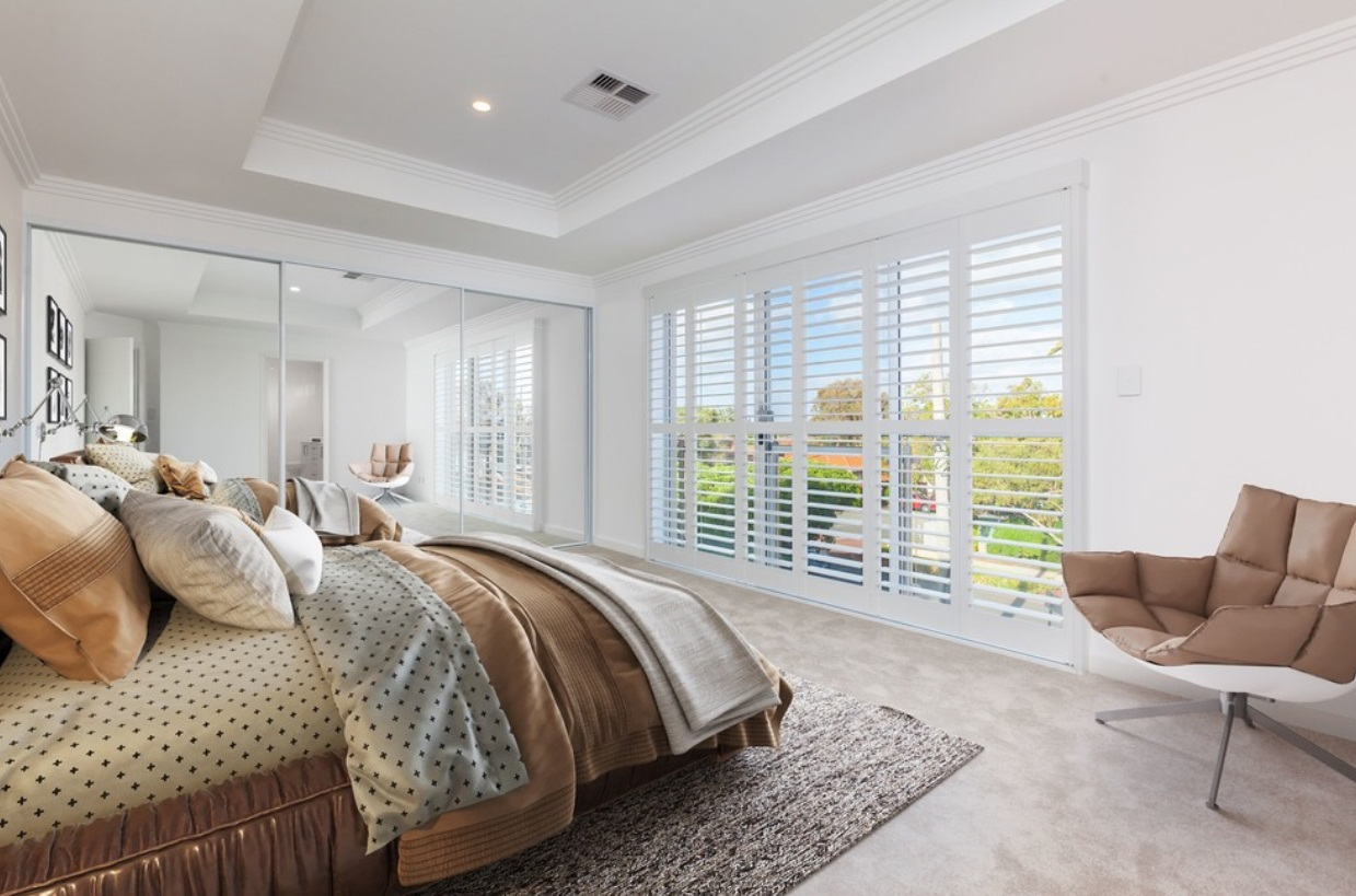 Master's bedroom facing a set of sliding doors and a closet with mirror sliding doors o the side