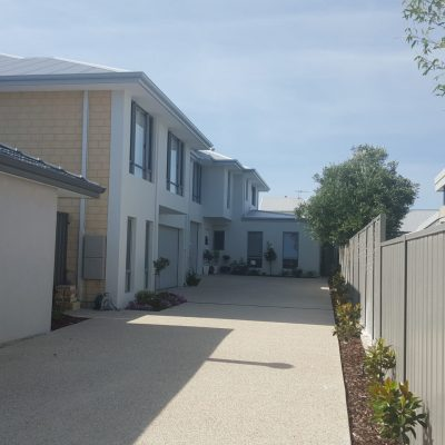 Two-storey house with a long fenced backyard