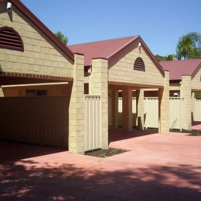 3 identical garages with red flooring